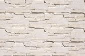 picture of tile cladding  - White cladding tiles imitating stones in sunny day - JPG