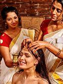 picture of panchakarma  - Young woman having head ayurveda spa treatment - JPG