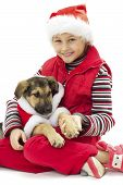stock photo of christmas puppy  - a child and  a puppy in Christmas costumes - JPG