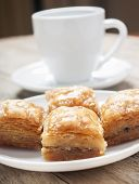 pic of baklava  - baklava close up in white plate with coffee - JPG