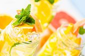 image of infusion  - Infused water with fresh citrus fruits and ice. ** Note: Shallow depth of field - JPG