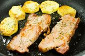 stock photo of gold panning  - Bacon and potatoes fried in a pan - JPG