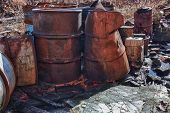 image of day judgement  - Group of old rusty barrels with toxic chemical waste - JPG