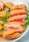 stock photo of duck breast  - baked duck breast with zucchini and carrots on white plate - JPG