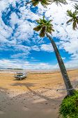 picture of tropical island  - Boat At The Seashore on a tropical island on a tropical island photographed with fisheye lens  - JPG
