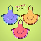 picture of apron  - Colored hand drawn aprons on the green background - JPG