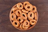 stock photo of bagel  - Top view of bagels in a wooden bowl - JPG