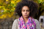 image of afro hair  - Close up portrait of a beautiful young mixed race girl with afro hair - JPG