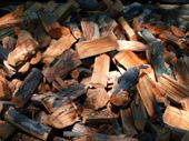 foto of firewood  - Defocused and blur image of large pile of firewood for barbecues and picnics on the nature - JPG