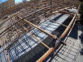 foto of reinforcing  - Urban construction site with metal reinforcement focus on foreground with wide angle fisheye view - JPG