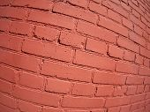 foto of fragmentation  - A fragment of a brick wall painted with wide angle fisheye lens diagonal view - JPG