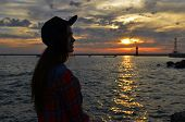 picture of humility  - summer beautiful girl at sunset on the sea - JPG