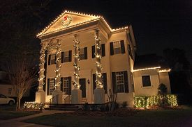 stock photo of roof-light  - A Colonial House with a lot of Christmas Lights - JPG