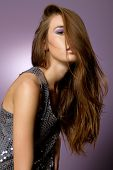 Beautiful young long hair brunette woman with high fashion outfit