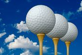 Three Golf Balls & Tees on the right with clouds and sky background.