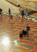 image of amtrak  - a train station interior with commuters and bags - JPG