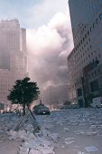 NEW YORK - SEPTEMBER 11:  Smoke lingers in the air and debris litters the area after the collapse of