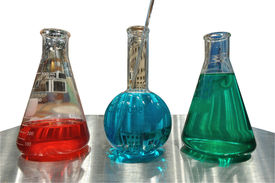 foto of pyrex  - A picture of medical colored flask on a silver table - JPG