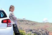 Car woman road trip on La Palma, Canary Islands. Observatory at Roque de los Muchachos in background