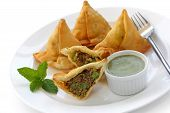 stock photo of samosa  - keema samosa with fresh mint dipping sauce  - JPG