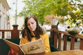 Beautiful Happy Caucasian Young Smiling Brown-hair Woman In Yellow Coat Reading, Ordering From Menu poster