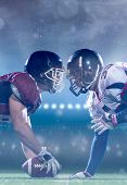 american football players are ready to start a match on modern field at night poster
