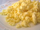 stock photo of scrambled eggs  - A delicious plate of scrambled eggs on a white background - JPG