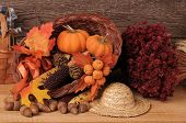 Fall Still life with Pumpkins, cornucopia and Indian Corn. Horizontal Composition.