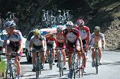 RUNNING SPRINGS, CA - MAY 21: Cyclists, followed by team cars, tackle  Stage 6 of the Amgen Tour of