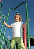 Little Girl On Playground Equipment