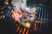 Upturning Of Fried Steak On Grill Pan, Closeup poster