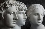 Gypsum Copy Of Ancient Statue Apollo, Antinous And Venus Head On Dark Textured Background. Plaster S poster