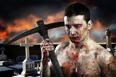 Male zombie in a cemetery, undertaker with pick axe