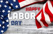 US American flag on worn white wooden background. For USA Labor day celebration. With Happy Labor Da poster
