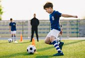 Children Training Football Dribbling In A Field. Kids Running The Ball. Players Develop Soccer Dribb poster