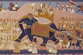 stock photo of courtier  - Colorful indian mural in the fort at Jodhpur showing a royal procession including elephant and courtiers from the Rajput era
