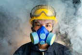 A Rescue Worker Wears A Respirator In A Smokey, Toxic Atmosphere. Image Show The Importance Of Prote poster
