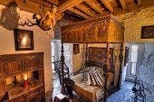 BUNRATTY, IRELAND - FEB 19: Ancient bedroom interior of 15th century Bunratty castle, traditional Ir