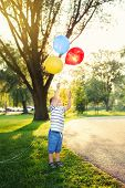 Cute Adorable Little Caucasian Boy Toddler Child With Colorful Balloons In Park Outdoor. Kid Enjoyin poster