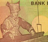 INDONESIA - CIRCA 2008: Woman at Hand Loom on 5000 Rupiah 2008 Banknote from Indonesia.
