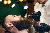 Cutting Mustache With Sharp Scissors. Male Barber In Black Hygienic Gloves Concentrate In Scrupulous poster