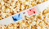 stock photo of matinee  - 3D Glasses and some popcorn - JPG