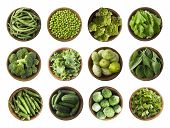 Vegetables Isolated On A White. Squash, Green Peas, Broccoli, Kale Leaves And Green Bean In Wooden B poster