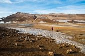 The Landscape Of Hverir Geothermal Mud Pool And Volcanic Hillside Near Myvatn Geothermal Area In Ice poster