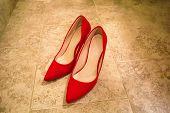 Beautiful Red Velvet Bride Shoes On Floor poster
