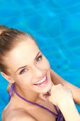 stock photo of close-up  - Close up of happy girl she standing in swimming pool - JPG