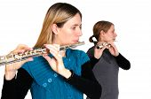 stock photo of transverse  - Two young women playing transverse flute isolated on white background - JPG