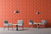 Interior Of Modern Office Lounge Area With Orange Geometric Pattern Walls, Concrete Floor, Comfortab poster