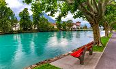 City Park Along The Bank Of Aare River In Old City Of Interlaken, Important Tourist Center In The Be poster