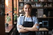Smiling Waitress Or Cafe Business Owner Entrepreneur Looking At Camera poster